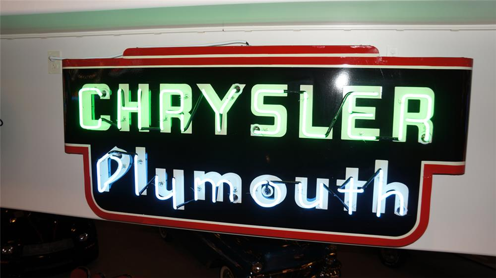 Circa 1930's-40's Chrsyler-Plymouth single-sided neon porcelain dealership marquee sign. - Front 3/4 - 179518