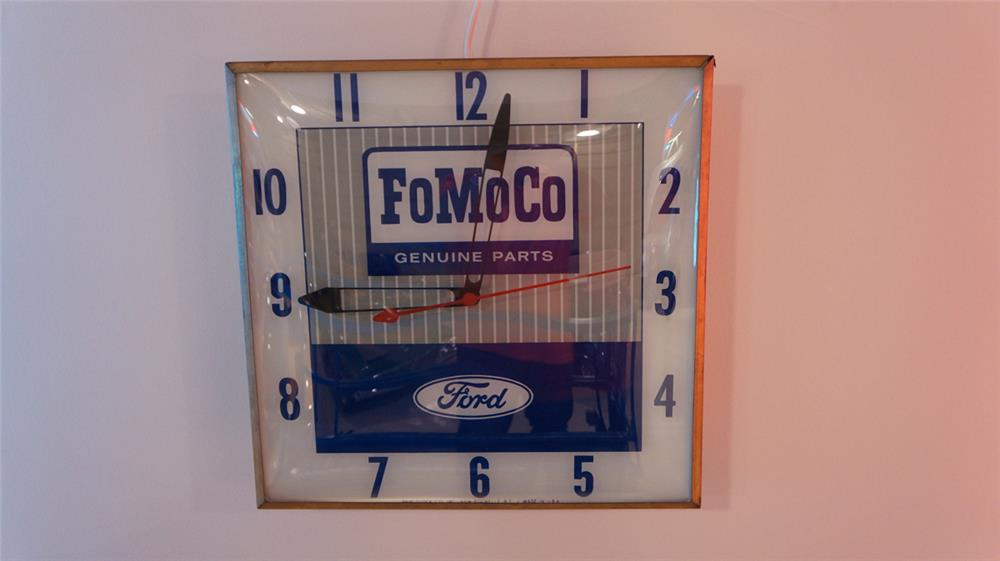 Late 1950's-early 60's Ford FoMoCo Genuine Parts glass faced light-up dealership clock by Pam. - Front 3/4 - 179537