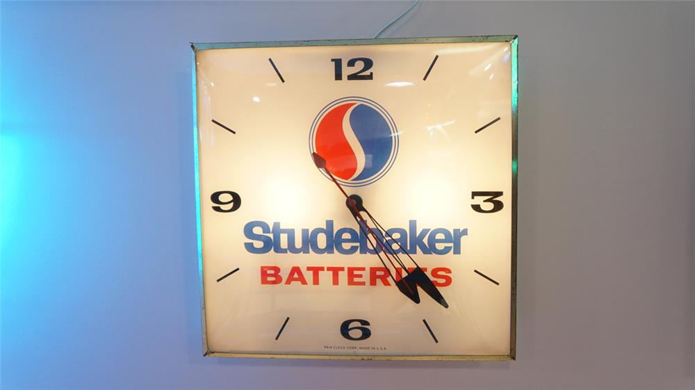 Scarce late 1950's-early 60's Studebaker Batteries glass faced light-up dealership clock. - Front 3/4 - 179550
