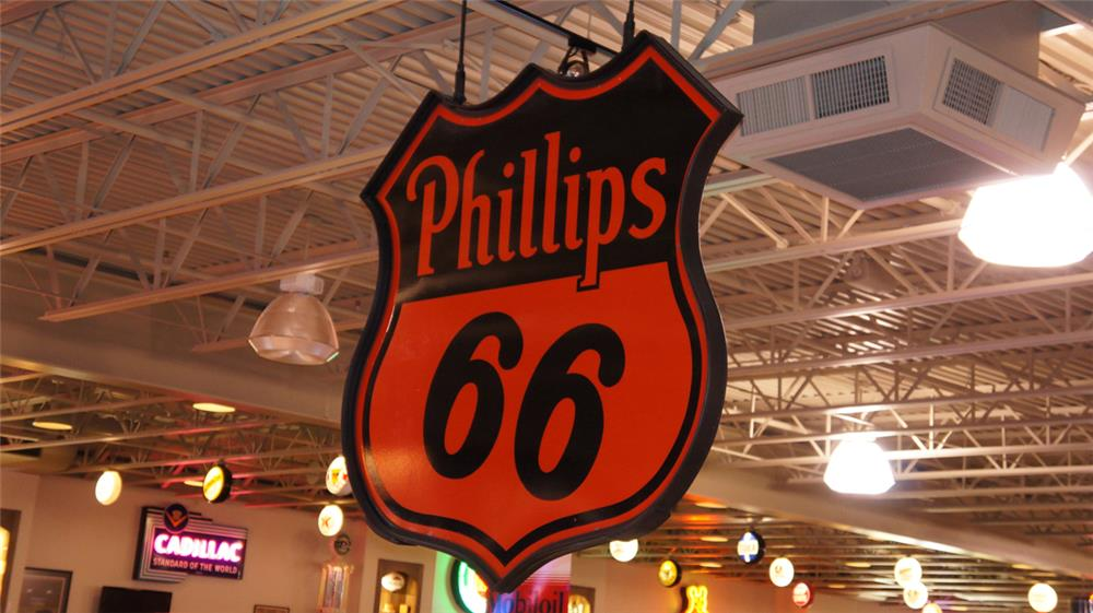 Large Phillips 66 double-sided shield shaped porcelain service station sign. - Front 3/4 - 179559
