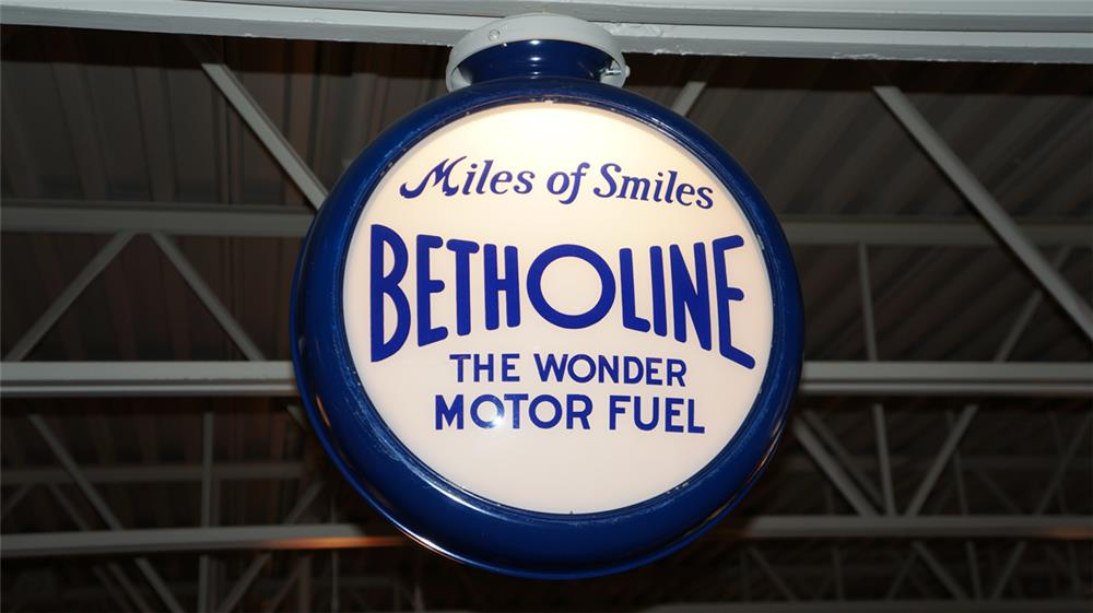 "Uncommon circa 1930's Betholine ""Miles of Smiles"" gas pump globe in a restored metal body. - Front 3/4 - 179612"