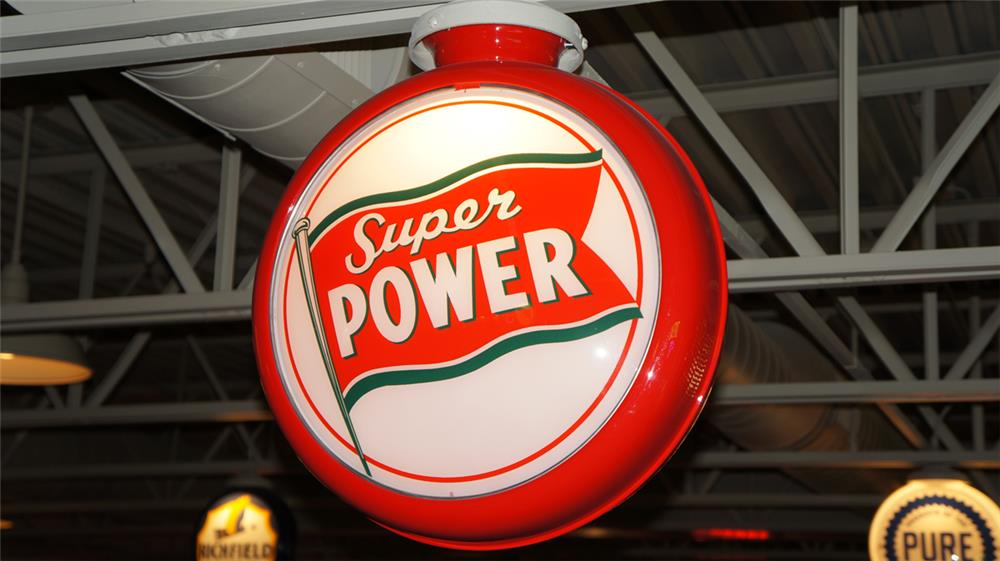 Stunning 1930's Super Power Gasoline with flag graphic gas pump globe in a restored metal body. - Front 3/4 - 179624