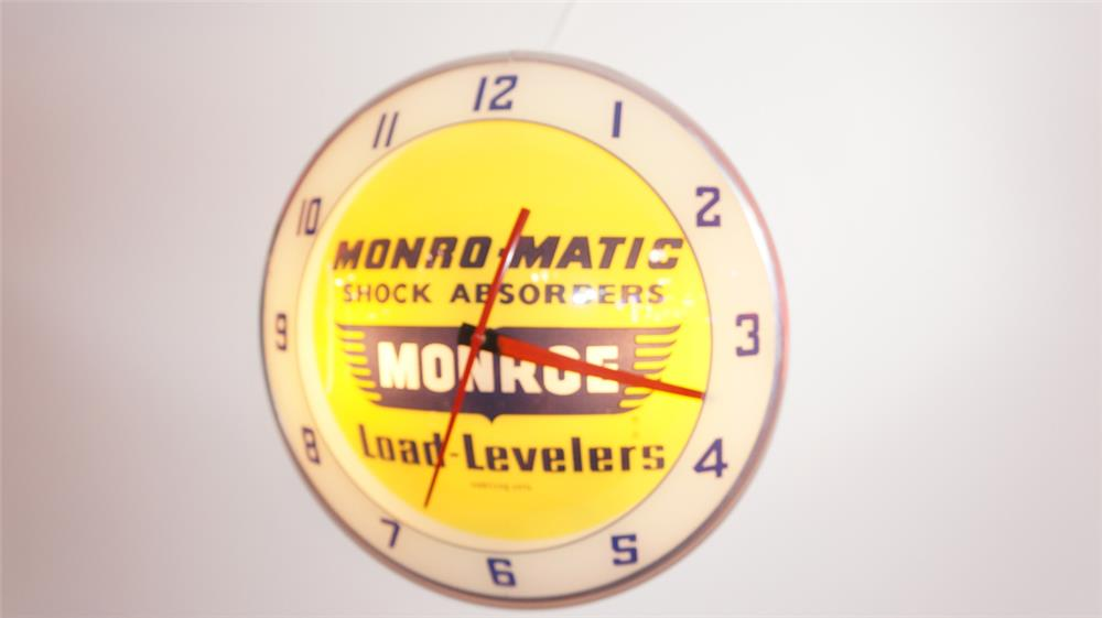 1950'-60's  Monroe Shock Absorbers double-bubble light-up automotive garage clock. - Front 3/4 - 179684
