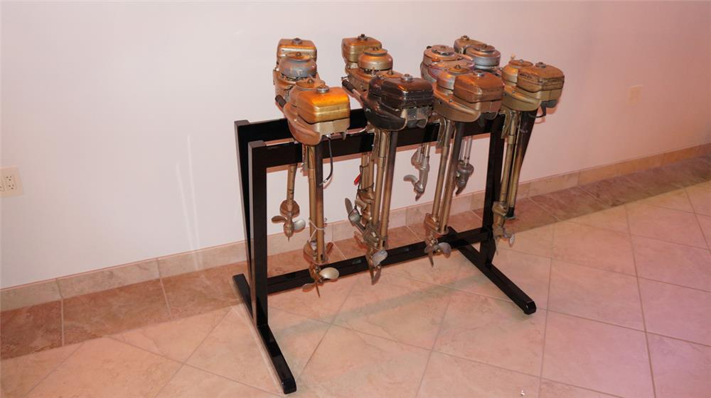 Display rack of eight 1930's outboard motors consisting of Neptune, Evindrude and Wards. - Front 3/4 - 179769