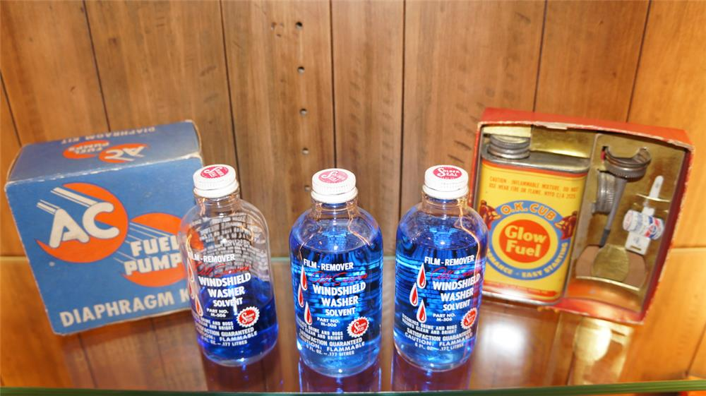 Lot consisting of three 1950's Windshield Washer Solvent bottles, AC Fuel Pump box and a Cub Glow Fuel tin still in the box. - Front 3/4 - 179845
