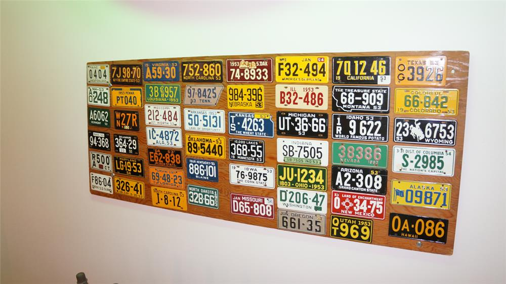 Miniature set of 148 1953 pressed steel license plates for all of the states. - Front 3/4 - 179921
