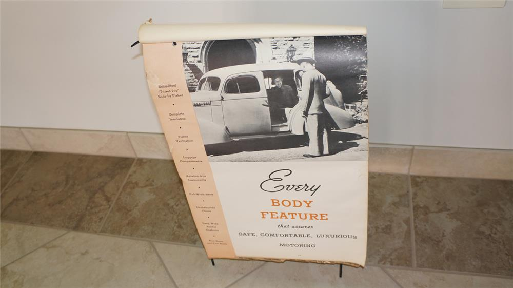 "1935 Oldsmobile ""Body Features"" showroom flip board filled with illustrative photos and specifications. - Front 3/4 - 180092"