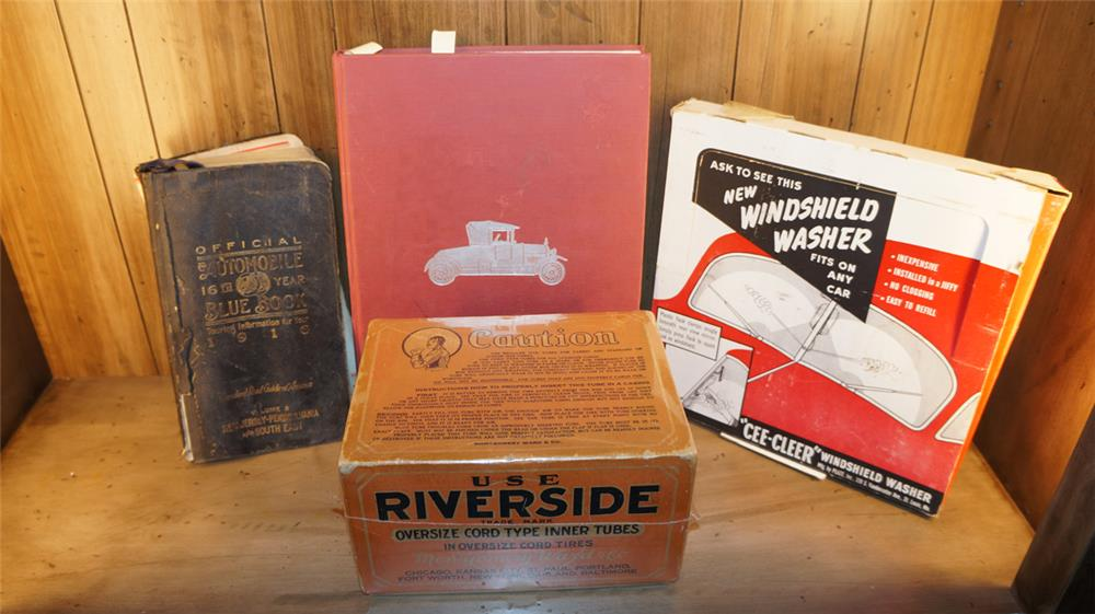 Lot consisting of a 1916 Automotive Blue Book, 1940's Windshield Washer Display, 1930's Riverside Tubes box and an automotive book. - Front 3/4 - 180115