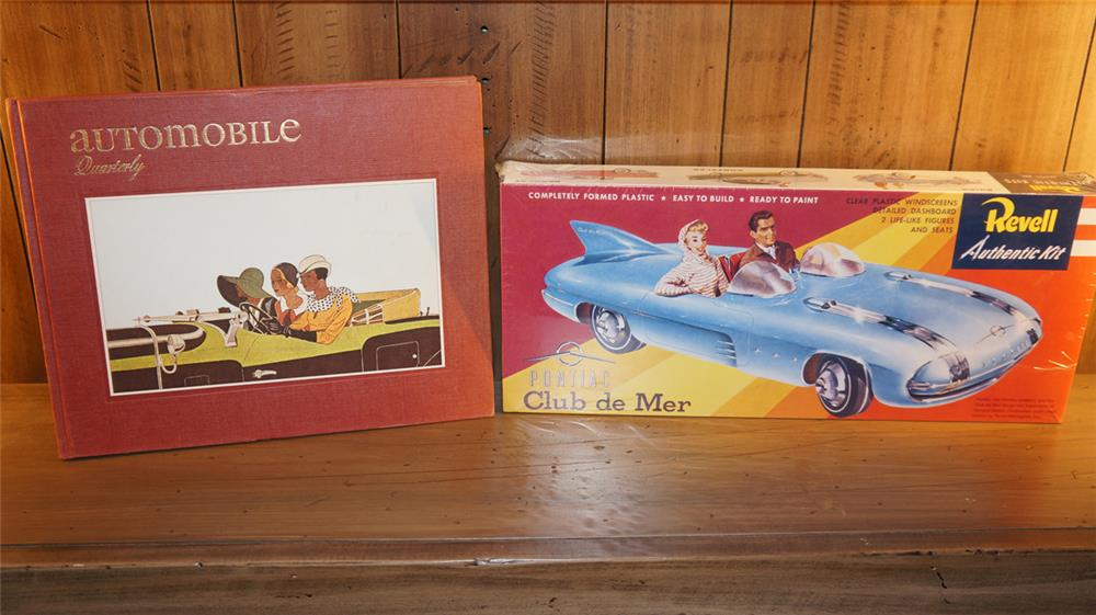 Lot consisting of an unused 1960's-70's Revell Club De Mer model set and a 1974 Automobiles quarterly book. - Front 3/4 - 180134