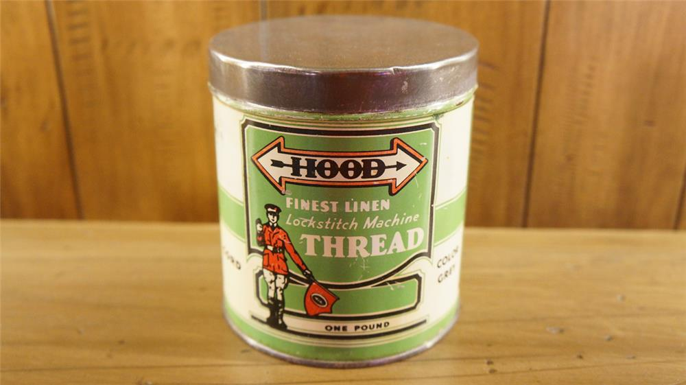 1920's-30's Hood Tires Lockstitch Machine Tread tin with Hood man graphics. - Front 3/4 - 180137