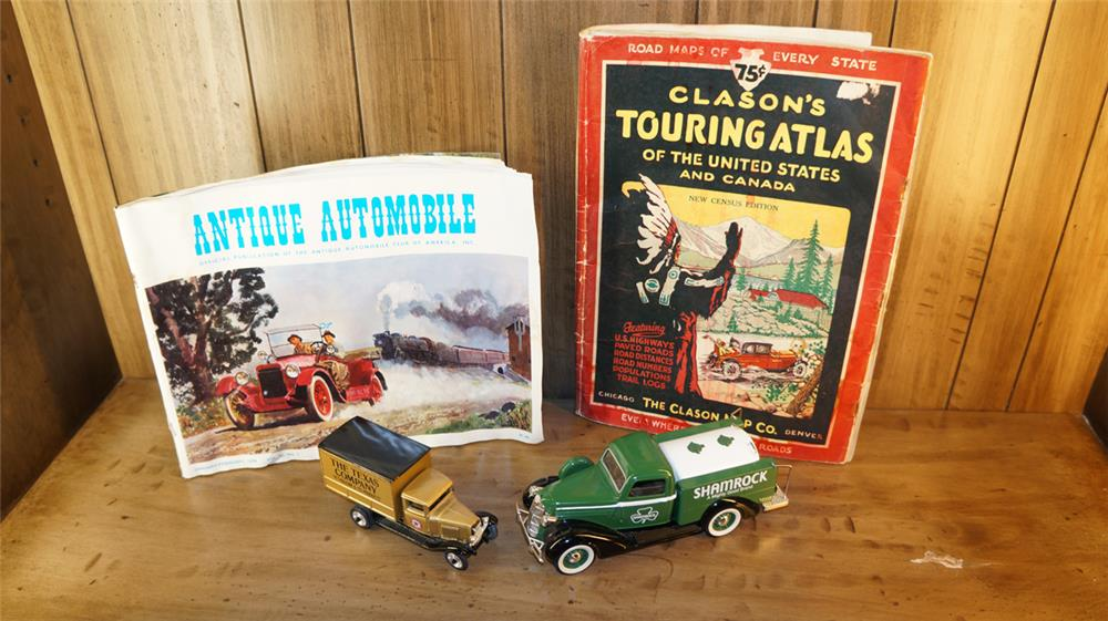 Lot consisting of a 1920's Clason's Touring Atlas, Antique Automobiles book, and two die-cast oil company delivery trucks. - Front 3/4 - 180143