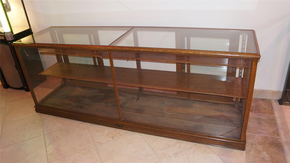Large turn of the century wooden showcase with beveled inset glass. - Front 3/4 - 180228