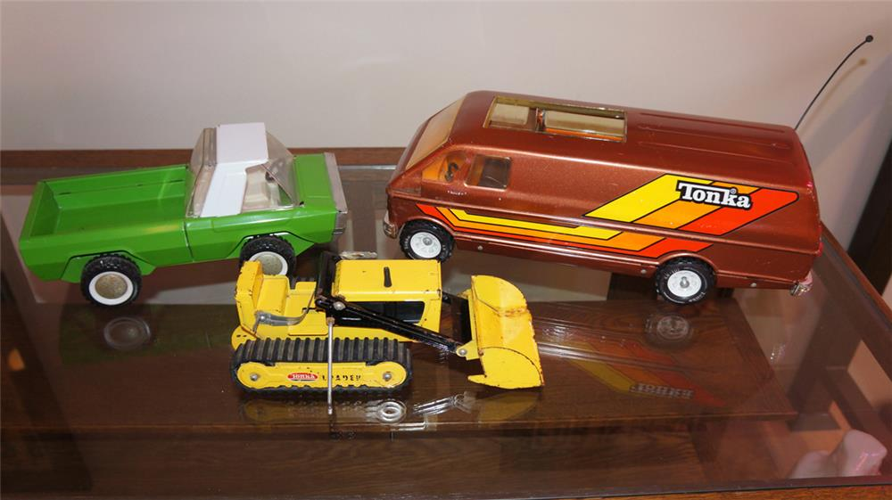 Lot of three 1960's-70's Tonka Trucks including pick up, van and front end loader. - Front 3/4 - 180229