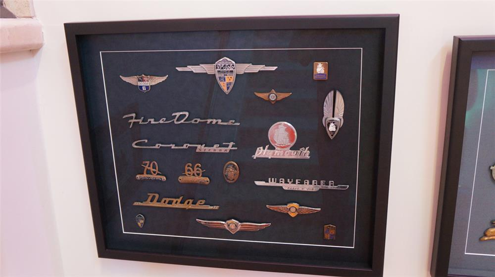 Exquisite framed display board featuring 17 Plymouth, Dodge, DeSoto automobile badges from 1920's-50's. - Front 3/4 - 180270