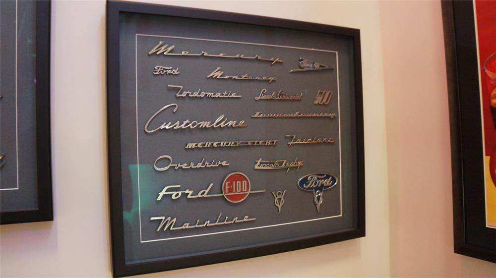 Fabulous framed display board featuring 17 Ford and Mercury automobile badges from the 1950's. - Front 3/4 - 180272