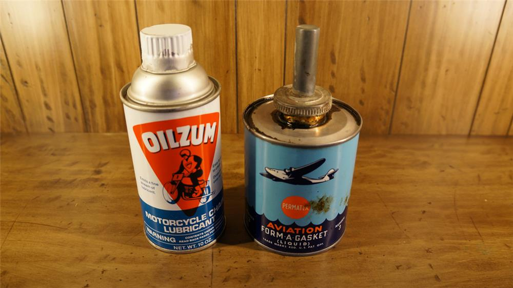 Lot consisting of a 1930's Permatex Aviation Gasket sealer tin and a Oilzum Motorcycle Oil tin. - Front 3/4 - 180290
