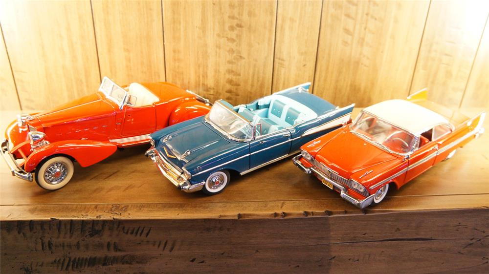 Lot of three Danbury Mint die-cast classic cars consisting of a 34 Packard, 57 Chevy Bel-Air and a 58 Plymouth Fury. - Front 3/4 - 180298