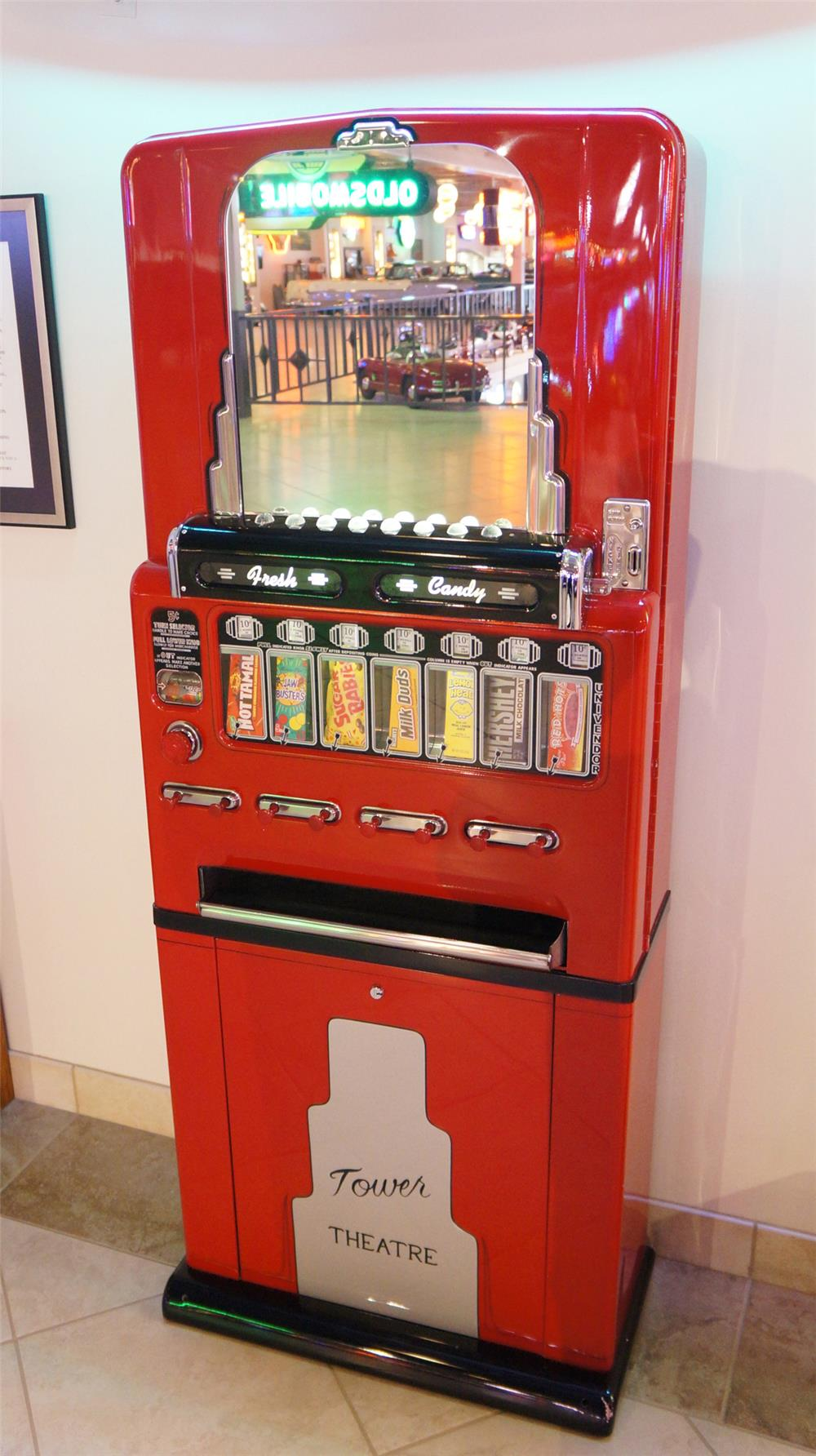 Beautifully restored 1930's-40's Stoner eight selection movie theater candy machine with gum dispenser. - Front 3/4 - 180319