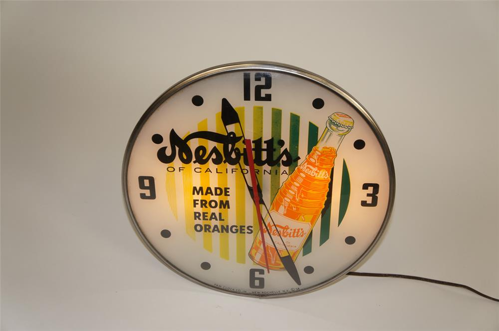1958 Nesbitt's of California glass faced light-up clock by Pam. - Front 3/4 - 182165