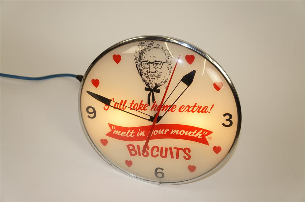 "1960's Kentucky Fried Chicken ""Y'all Take Home Extra Biscuits"" glass faced light-up clock - Front 3/4 - 182187"