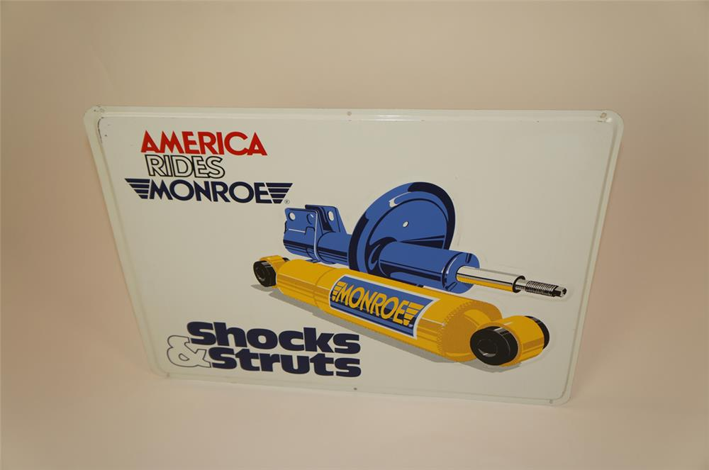 NOS Monroe Shock Absorbers single-sided embossed tin sign with graphics. - Front 3/4 - 182224