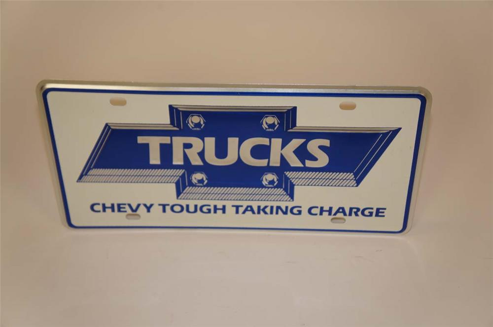 Late 1970's-early 80's Chevy Tough Taking Charge embossed showroom sales license plate sign. - Front 3/4 - 182279