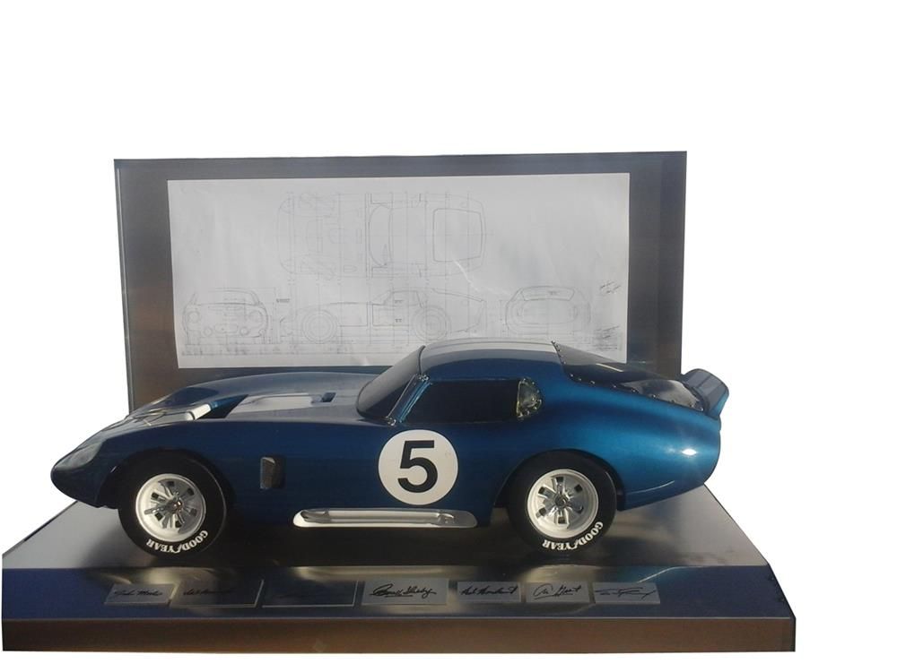Outstanding 1965 1/4 scale model Shelby Daytona Cobra presented on a custom display boasting the original signatures of Carroll Shelby and others. - Front 3/4 - 182497
