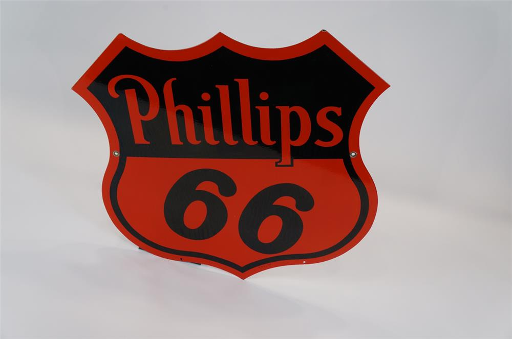 Addendum Item - N.O.S. 1954 Phillips 66 double-sided porcelain shield-shaped service station sign. - Front 3/4 - 183113