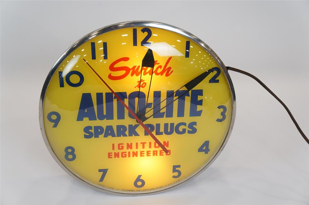 Addendum Item - 1950's Auto-Lite Spark Plugs glass faced light-up clock by Telechron.  Lights but currently not running. - Front 3/4 - 183129