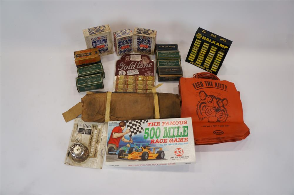 Addendum Item - Lot consisting of vintage automotive garage parts, counter-top displays and Esso promotional bags. - Front 3/4 - 183160