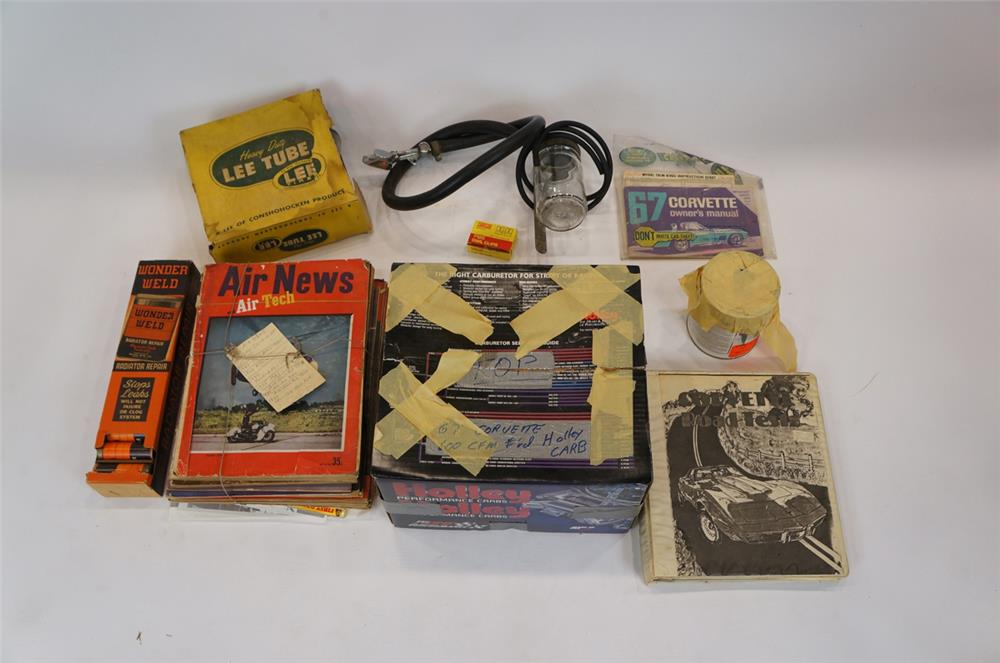 Addendum Item - Lot consisting of vintage Air News Magazine, Holley Carburetor, 1967 Corvette owners manual and other garage items. - Front 3/4 - 183169