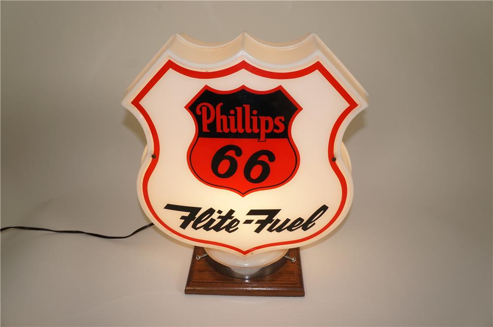 Highly prized Philips 66 Flite Fuel shield shaped gas pump globe with glass lenses. - Front 3/4 - 184617
