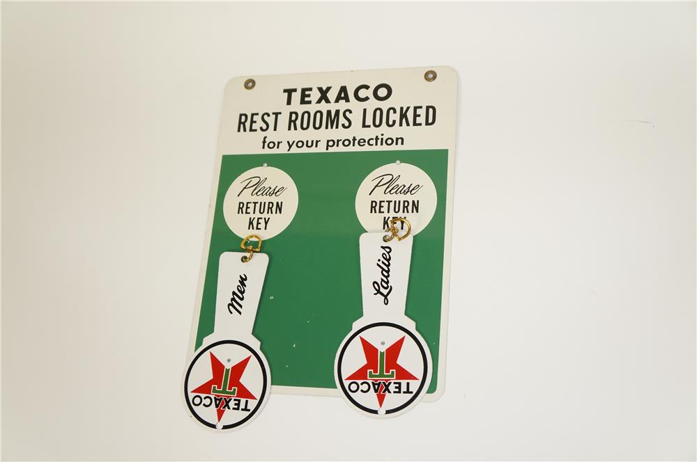 1950s Texaco Rest Rooms Locked for your protection tin service station sign with original die-cut metal key fobs. - Front 3/4 - 184656