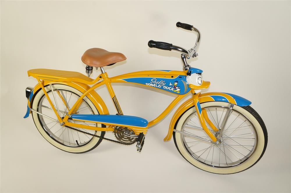 Lot #5862 Museum quality 1949 Shelby Donald Duck restored bicycle with lit head and tail light.