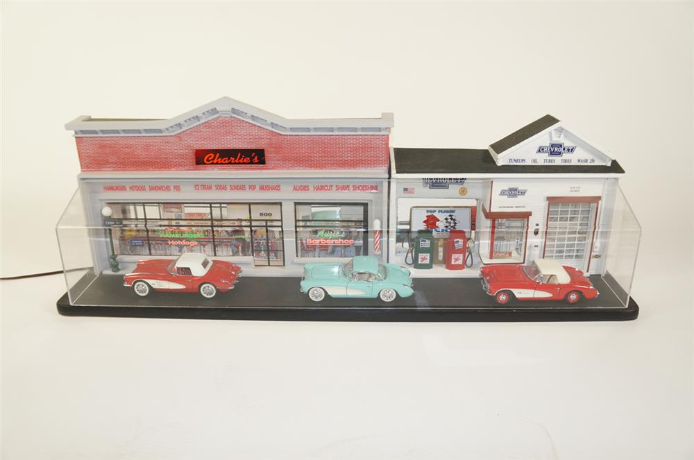 Very cool light-up vintage street seen display with die-cast classic corvettes. - Front 3/4 - 184773