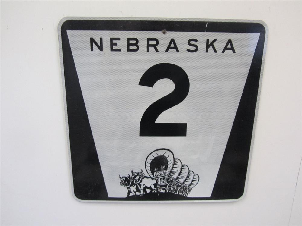Vintage Nebraska Highway 2 metal road sign with covered pioneer wagon logo. - Front 3/4 - 184845