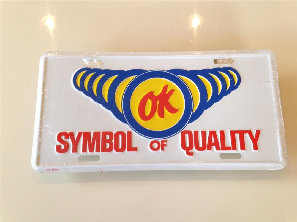 1950s-60s Chevrolet OK Used Cars showroom sales license plate sign still in the original shipping plastic. - Front 3/4 - 184862