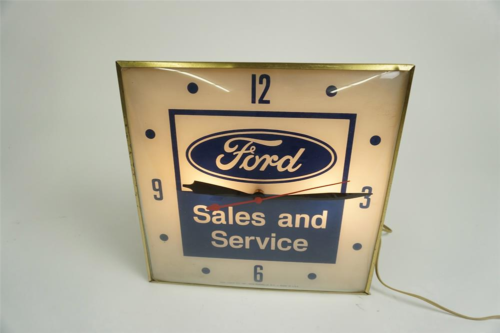 Highly desirable 1960s Ford Sales and Service glass faced light-up showroom dealership clock. - Front 3/4 - 185946