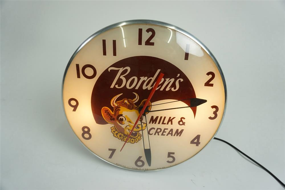 Exceptional 1950s Borden's Milk and Cream glass faced light-up clock with Elsie the Cow graphics. - Front 3/4 - 185947
