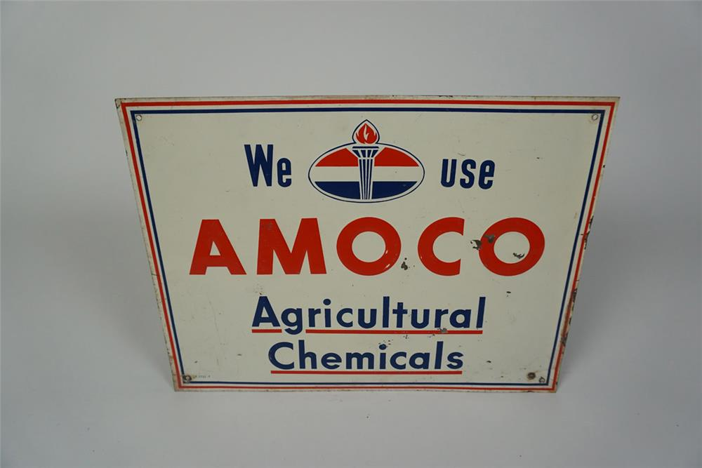 "Circa 1950s-60s ""We Use Amoco Agricultural Chemicals"" single sided embossed tin sign with torch logo. - Front 3/4 - 186035"