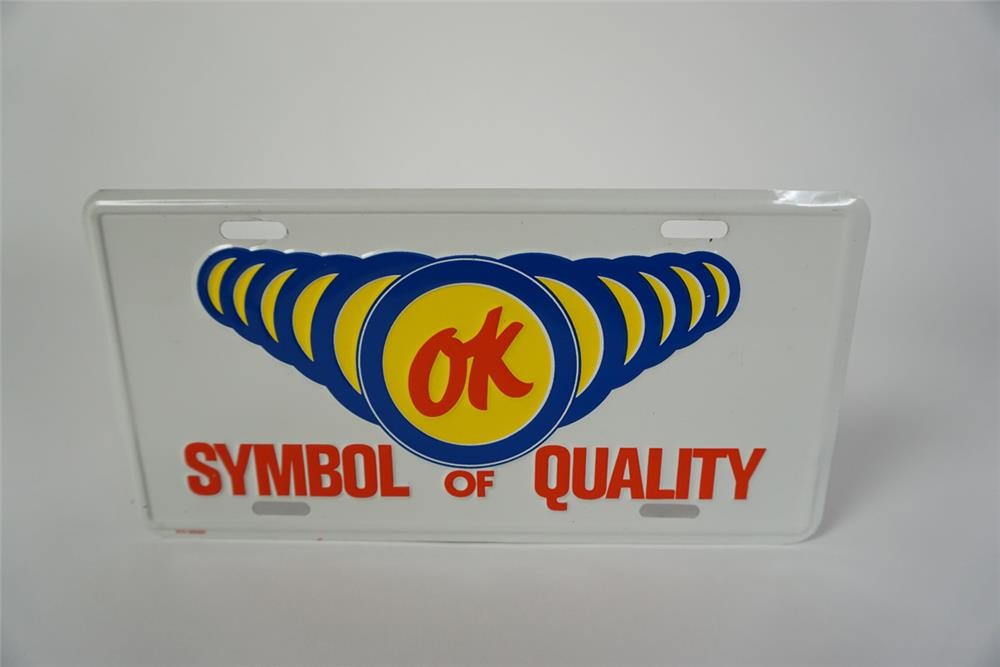 "NOS 1960s Chevrolet OK Used Cars ""Symbol of Quality"" embossed tin license plate dealership showroom sign. - Front 3/4 - 186066"