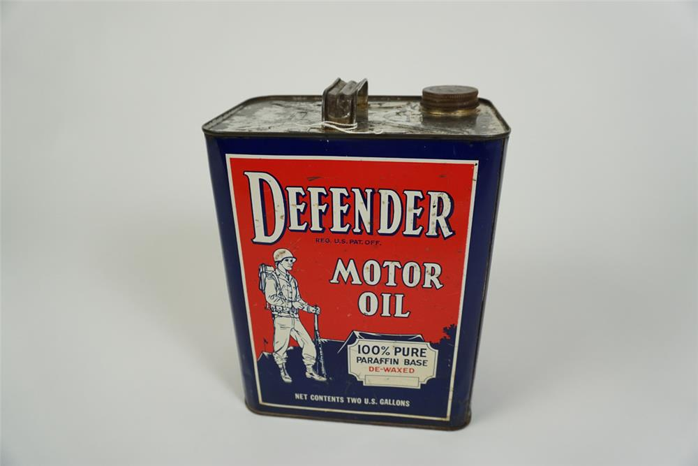 Impressive 1940s Defender Motor Oil one gallon tin can with graphic of a U.S. G.I. soldier. - Front 3/4 - 186215