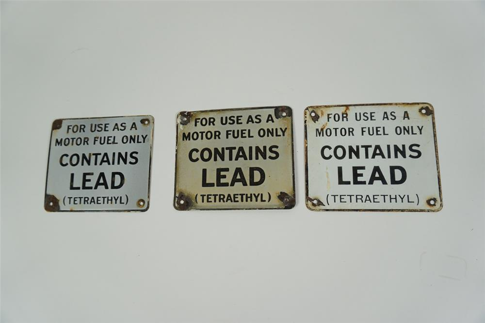 """Lot of three 1950s-60s """"Contains Lead"""" single-sided porcelain pump plate signs. - Front 3/4 - 186259"""