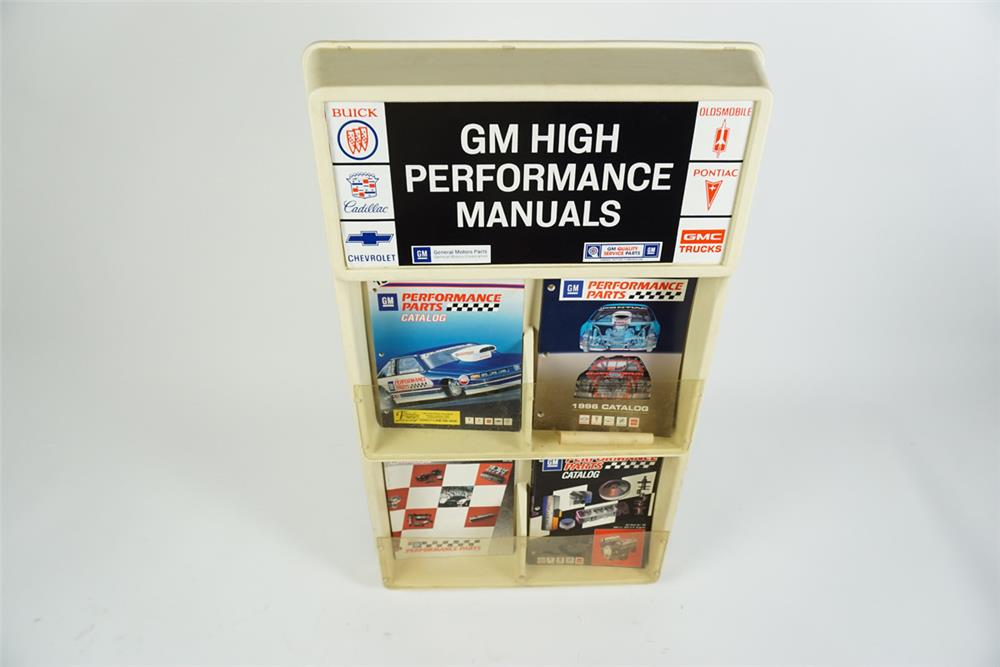 GM High Performance Manuals showroom display featuring the Buick-Cadillac-Chevrolet-Oldsmobile-Pontiac and GMC Trucks logos. - Front 3/4 - 186289