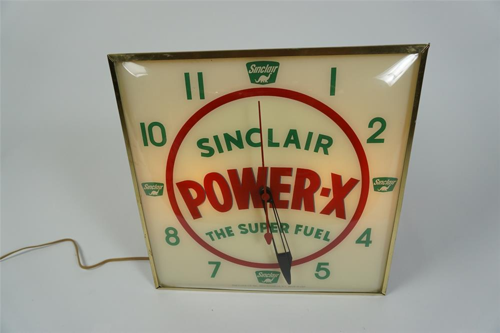 Scarce late 1950-early 1960s Sinclair Power-X Super fuel glass faced light-up clock by Pam. - Front 3/4 - 187605