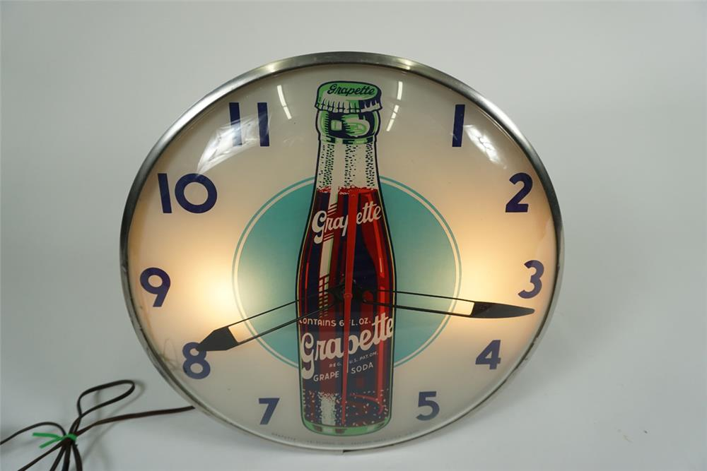Rare 1950s Grapette Soda glass faced light-up diner clock with bottle graphic. - Front 3/4 - 187615