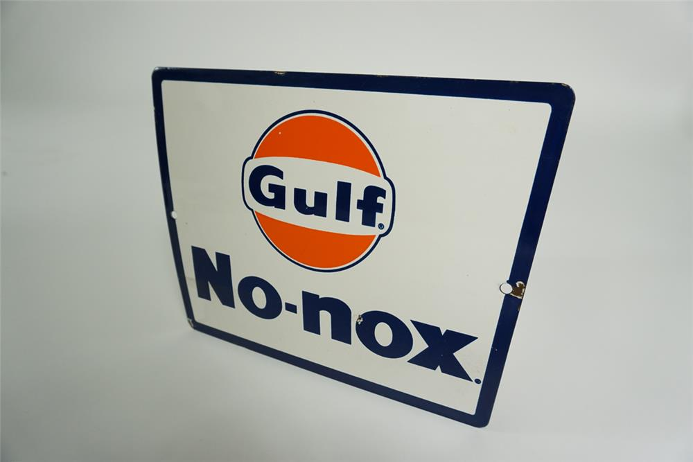 NOS late 1950s Gulf Oil No Nox single-sided porcelain pump plate sign. - Front 3/4 - 187653