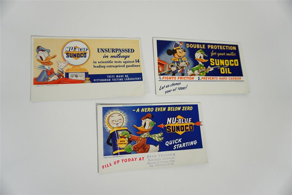 Lot of three circa 1930s Walt Disney Blue Sunoco Gasoline promotional service station ink blotters. - Front 3/4 - 187771