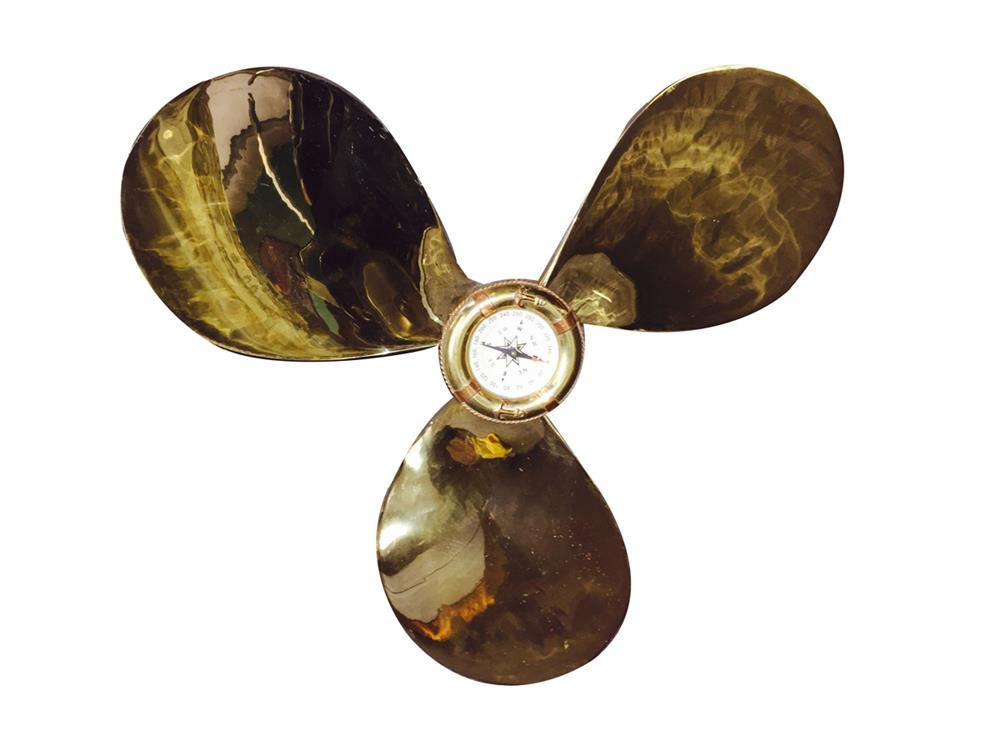 Brass ship propeller freshly polished with brass compass fitted in the center. - Front 3/4 - 187938