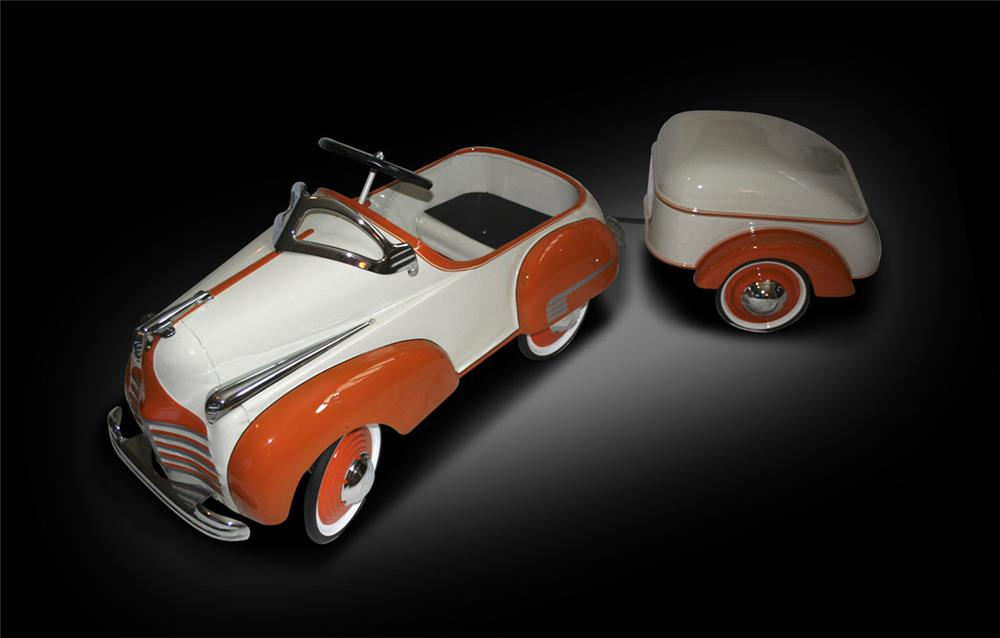 Exceptional restored 1950s Steelcraft Chrysler pedal car with custom Mullins trailer done in tangerine and cream. - Front 3/4 - 187954